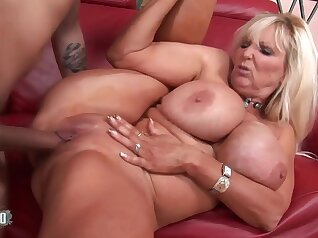 Busty Mature Babe Gives Rip And Fucks Young Guy