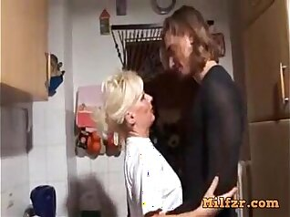 Blonde momk from Germany watches collegues mom with dildo