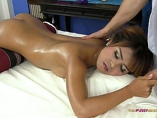 Asian cutie with oiled and well shaved pussy