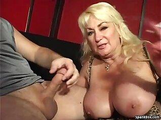 Busty mama giving neat blowjob