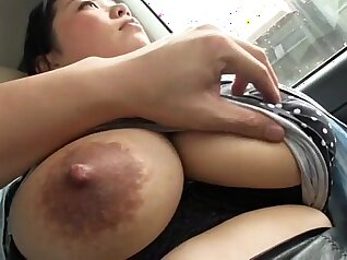 Curvaceous Japanese hottie plays with her natural tits on webcam