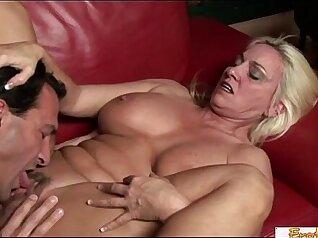 Mature blonde MILF gives a BJ to an older man