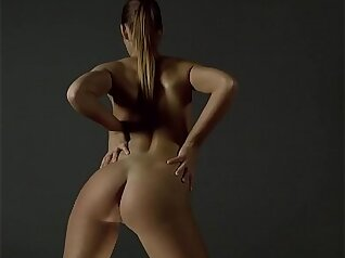 Blonde and Brunette Silvia Will showcasing her ass in a sport seat